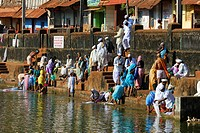 India, Karnataka, Gokarna, one of the most sacred places in Southern India for Hindus, pilgrims and brahman making ablutions on the ghats of the large...