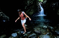 France, Guadeloupe French West Indies, Basse Terre, female hiker facing Cascade de Matouba Matouba Waterfall