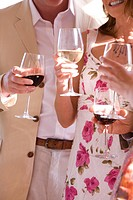Couples holding wine glasses
