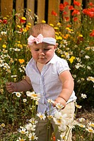 Cute One Year Old And Flowers