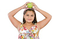 Adorable girl with apple