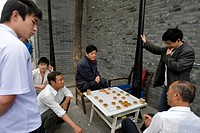 China, Beijing, game of Chinese Chess Xiangqi in one of the last Hutongs ancient streets which are beeing totally destroyed