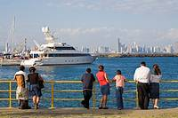 People looking at city skyline, Fuerte Amador Resort and Marina, Amador Causeway, Panama City, Panama