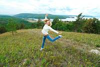 30 years old woman jumping in Molodeskiy Kurgan National Park in Toglyatty, Samara Region, Russian Federation, Russia