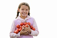 Girl carrying bunch of tomatoes, smiling, portrait, cut out