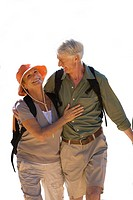 senior couple with rucksacks walking, cut out