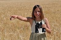 girl with binoculars in the field