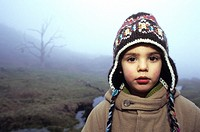 A young boy alone in the middle of the fog on the mountains. Serra do Ger&#234;s, Parque Nacional da Peneda-Ger&#234;s, Minho, Portugal