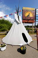 White Indian Teepees on display at Agawa Crafts and the Canadian Carver on Highway 17 Pancake Bay Ontario Canada
