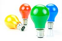 Colored light bulbs isolated against a white background