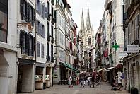 Shopping area, Rue de la Monnaie and cathedral in background, Bayonne. French Basque Country, Aquitaine, Pyrenees-Atlantiques, France