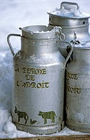 France, Savoie, Val d´Isere, La Ferme de l ´Adroit farm and cheese dairy, L´Etable d´Alain Restaurant, close up on milk cans from the dairy