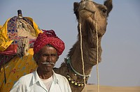 Camel driver with Dromedary in Thar desert, Rajasthan, India, Camelus dromedarius, One_humped Camel