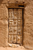 Mali, Dogon Country, Bandiagara Cliffs listed as World Heritage by UNESCO, acacia door decorated with Dogon