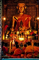 Laos, Luang Prabang, listed as World Heritage by UNESCO, Wat Xieng Thong Temple, built in 1560, monks praying