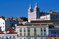 Portugal, Lisbon, roofs of Alfama district and Sao Vicente de Fora Church seen from Santa Lucia Mirador