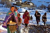India, Jammu and Kashmir, Ladakh Himalaya, Spiti Valley, Lhalung village, women bringing offering to Buchans