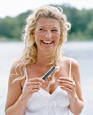 A smiling woman using a nail file Sweden.