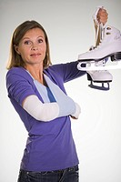 An injured woman holding skates.