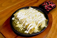 Close_up of enchiladas in a plate