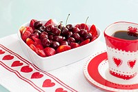 Close_up of a heart shaped bowl filled with assorted berries