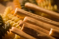 Close_up of breadsticks with pasta