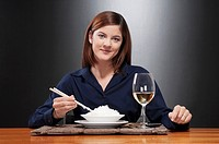 Portrait of a woman having rice and wine