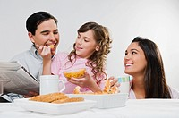 Close_up of a happy family eating breakfast