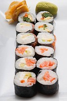 Close_up of sushi rolls with wasabi paste