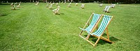 Row of deckchairs in Hyde Park, London, UK