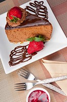 Chocolate mousse cake served with strawberries