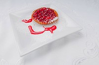 High angle view of a strawberry tart on a tray