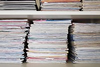 Pile of school folders, exercise books on shelf, close-up (thumbnail)