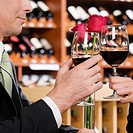 Business couple toasting with wine