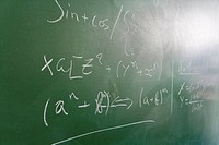 Mathematical formula written on green blackboard in classroom, close_up