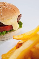 Close_up of a hamburger with French fries