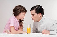 Man and his daughter drinking juice