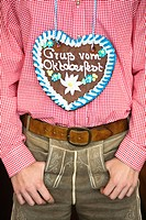 Detail of man wearing Gingerbread heart at Oktoberfest, Munich, Germany