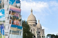 Postcard stand with Sacre Coeur basilica in background, Paris, France
