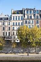 Facade of apartment houses by river Seine, Paris, France