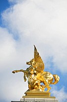 Detail of golden statue on Pont Alexandre_III bridge, Paris, France