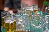 Table full of litre beer mugs, English garden, Munich, Germany (thumbnail)