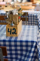 Cutlery in wooden box on typical German beer garden table, Munich, Germany (thumbnail)