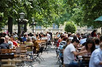 Large group of people in beer garden, Munich, Bavaria, Germany (thumbnail)