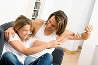 Couple fighting over remote control (thumbnail)
