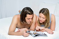 Young couple choosing TV programme