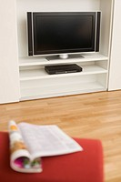 Flat screen TV and magazine