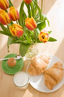 Continental breakfast still life with flowers (thumbnail)