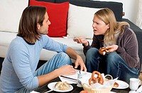 Young couple arguing at breakfast table