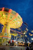 Illuminated fairground rides at night, Oktoberfest, Munich, Germany (thumbnail)